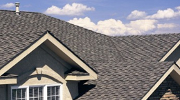 Enchanted Roofing installs shingles